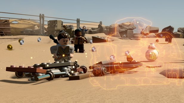 Das neue Multi-Build-System in Aktion: Orange glühende Silhouetten zeigen an, welche verschiedenen Konstrukte mit den herumliegenden Steinchen gebaut werden können.